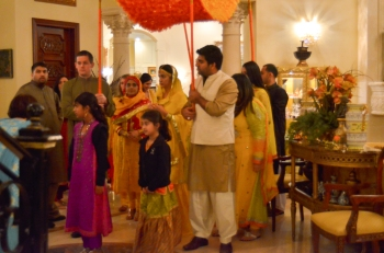 The Dholki line, led by the brides young cousins prepares to  bring the bride out to her public. The Dholki is carried by her brother, and his best friend.