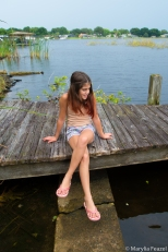 Sitting on the dock watching a snake swim by
