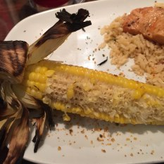 Fire Roasted Corn sprinkled with parmesan cheese.